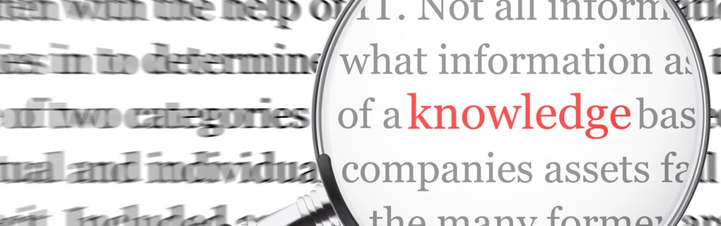 Magnifying glass focusing on the word knowledge